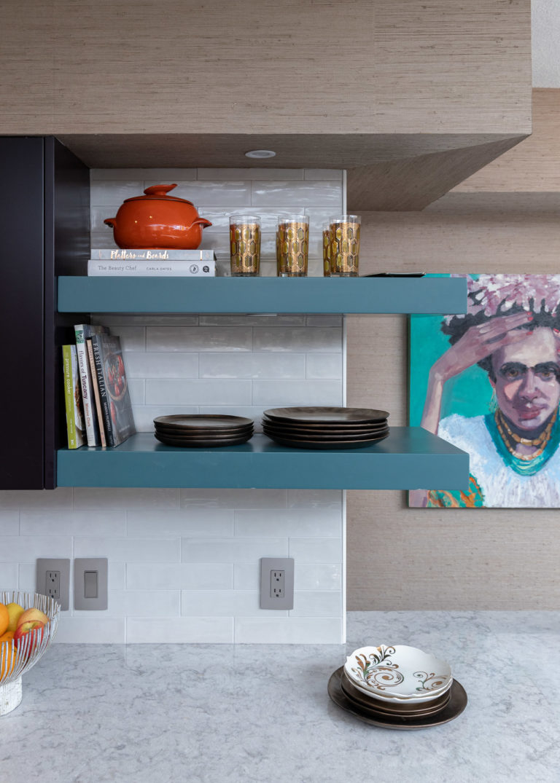 blue floating shelves, white tile backsplash, purple cabinets, nancy rhodes harper art , frida kahlo art, coastal condo remodel, kitchen remodel, pensacola beach florida