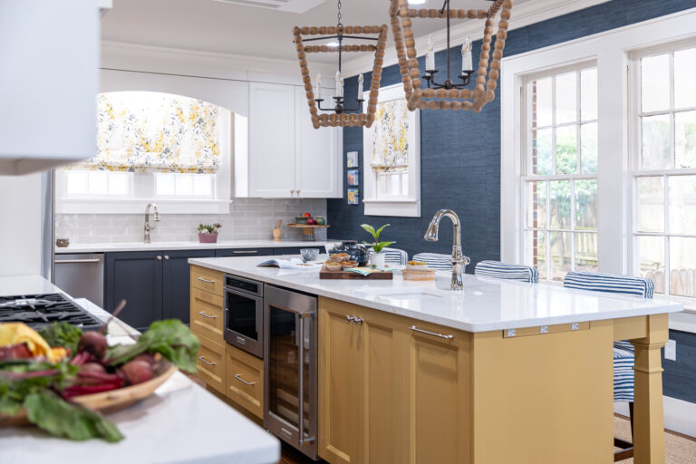 yellow kitchen island, blue lower cabinets, white upper cabinets