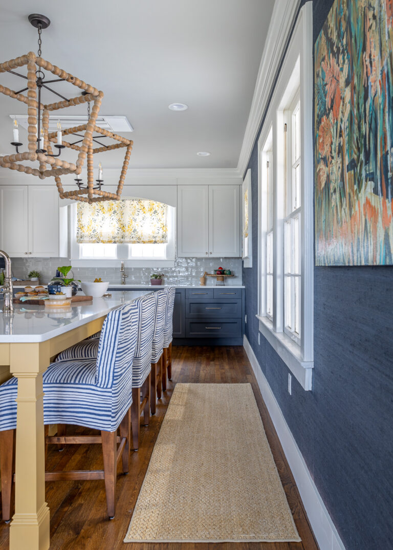 Yellow Kitchen island, blue lower cabinets
