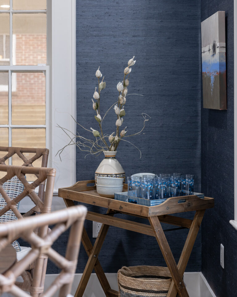 Blue textured grass cloth wallpaper in dining room