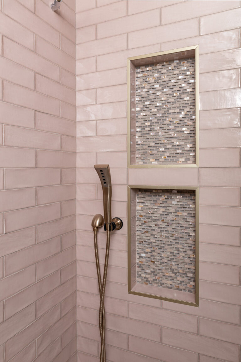 Pink Tiled Shower with Gold Plumbing and Accent Shower Nook