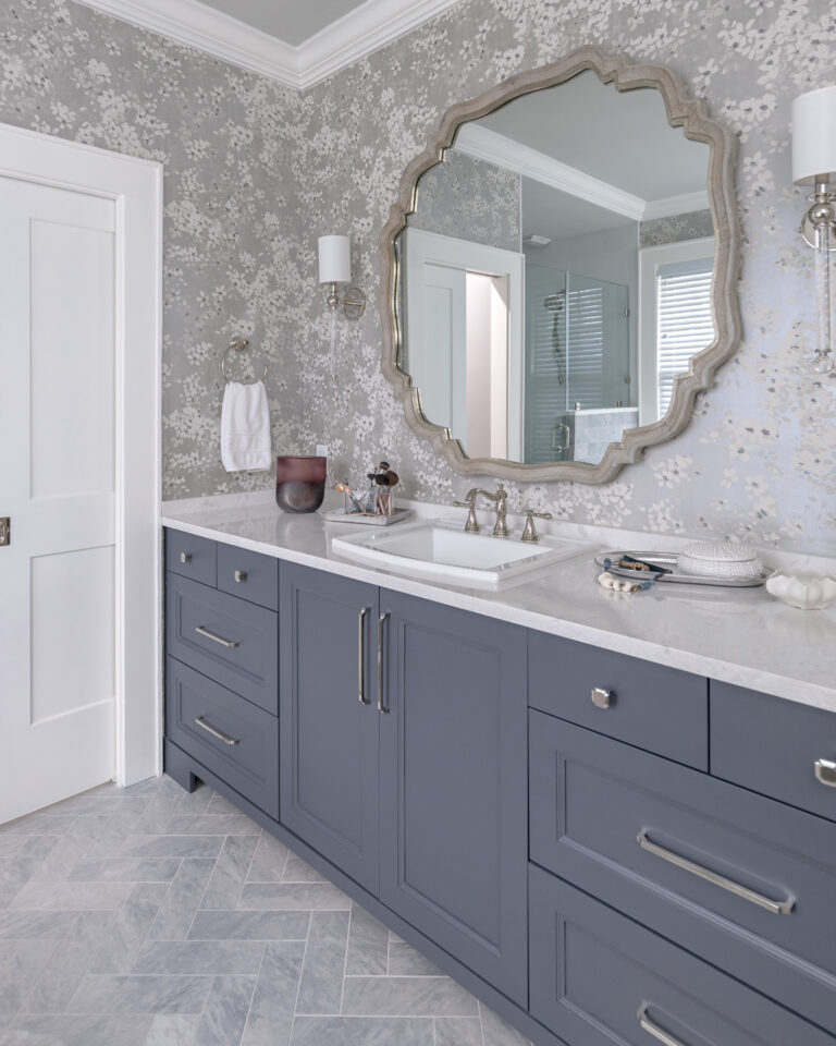 blue master bath vanity with grey and white floral wallpaper