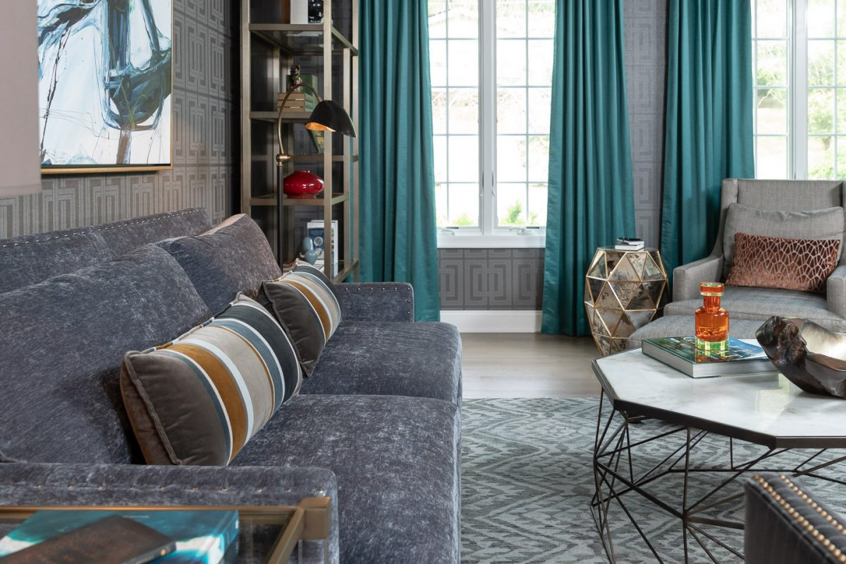 Colonial Living Room Makeover, New Jersey - Grasscloth wallpaper, teal curtains, velvet sofa, original art and dark furniture