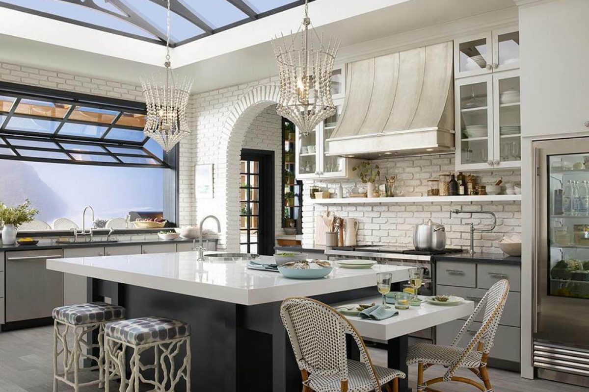 garden kitchen with vaulted ceiling kitchen island beautiful wood flooring white beaded hanging lights, garage style window, custom counterstools,