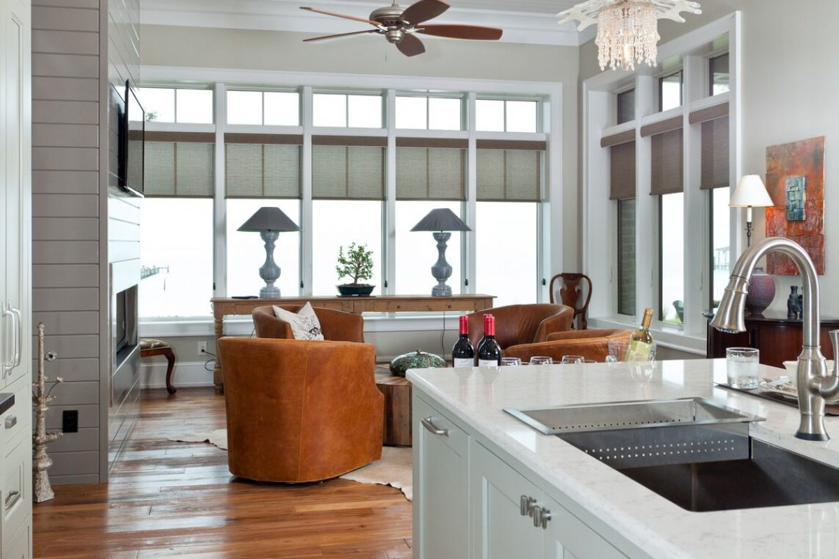 White and Blue Kitchen with Leather Chairs in Family Room